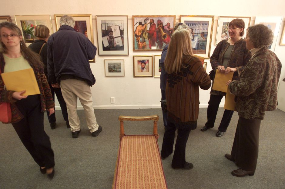 Art lovers gather during an annual member show of the Connecticut Pastel Society at Gallery 53.