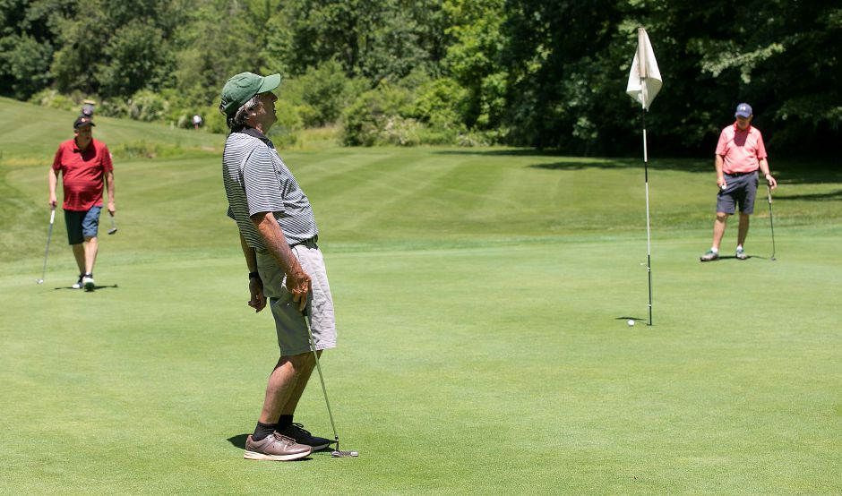 Enrico Buccilli, of Wallingford, reacts after just missing a birdie putt on Hole 15 at Hunter Golf Course in Meriden on  June 16. Hunter reported a record month for business in June. Dave Zajac, Record-Journal file photo