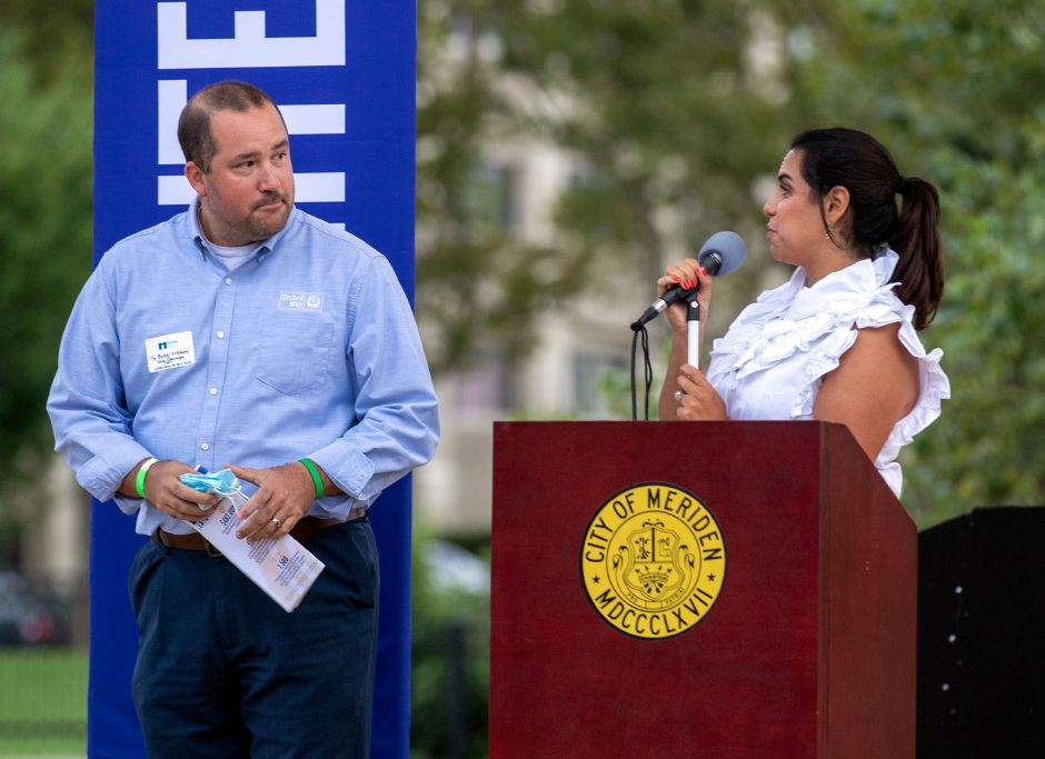 United Way 2021 Campaign Chair Ty Bongiovanni from Bongiovanni Insurance and Financial and Maria Campos-Harlow, executive director of the United Way of Meriden and Wallingford, kicks off the 2021 campaign during the 2020-21 United Way of Meriden and Wallingford Award Ceremony and Community Campaign Kick-Off Event at the Meriden Green Amphitheater on Thursday, September 17, 2020. Aaron Flaum, Record-Journal