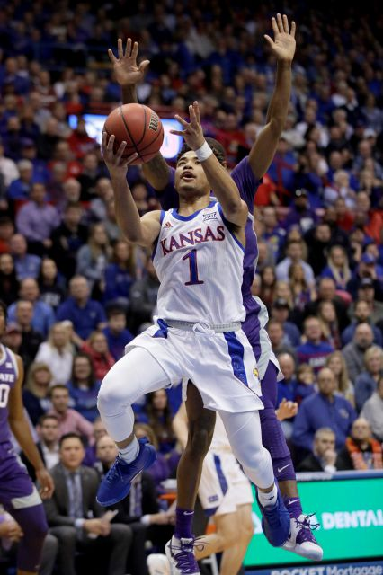 Kansas guard Devon Dotson (1) gets past Kansas State guard DaJuan Gordon, back, during the first half of an NCAA college basketball game in Lawrence, Kan., Tuesday, Jan. 21, 2020. (AP Photo/Orlin Wagner)