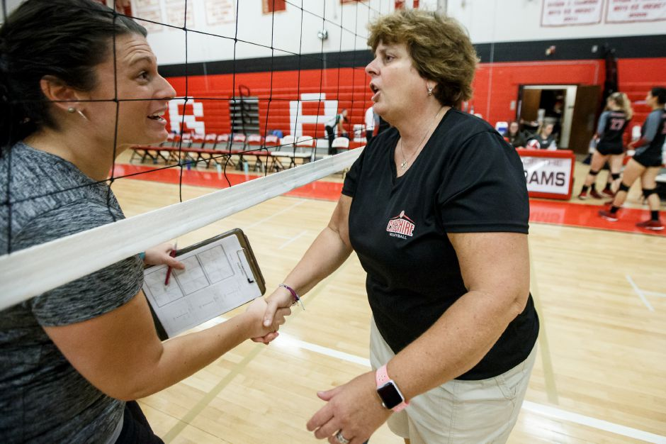 Cheshire volleyball coach Sue Bavone, right, saw her boys team win its seventh straight and improve to 8-1 with Wednesday's 3-0 sweep in Newtown. Record-Journal file photo