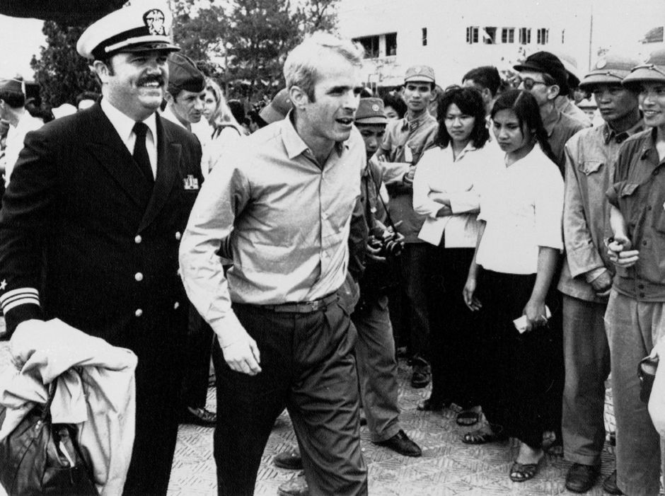 John S. McCain III is escorted by Lt. Cmdr. Jay Coupe Jr., public relations officer, March 14, 1973, to Hanoi