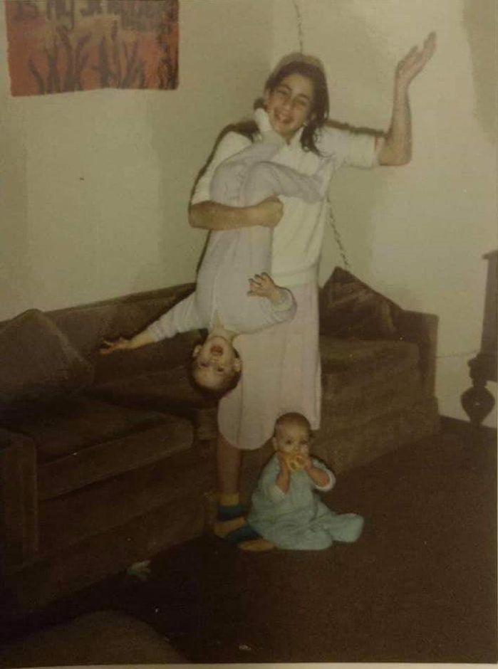 Family photos of Doreen Vincent, who went missing at age 12 from her father's Wallingford home in 1988. Doreen holding her brother, Paul Vincent, by his legs, with sister Sarah Vincent sits at her feet. | Contributed by Paul Vincent