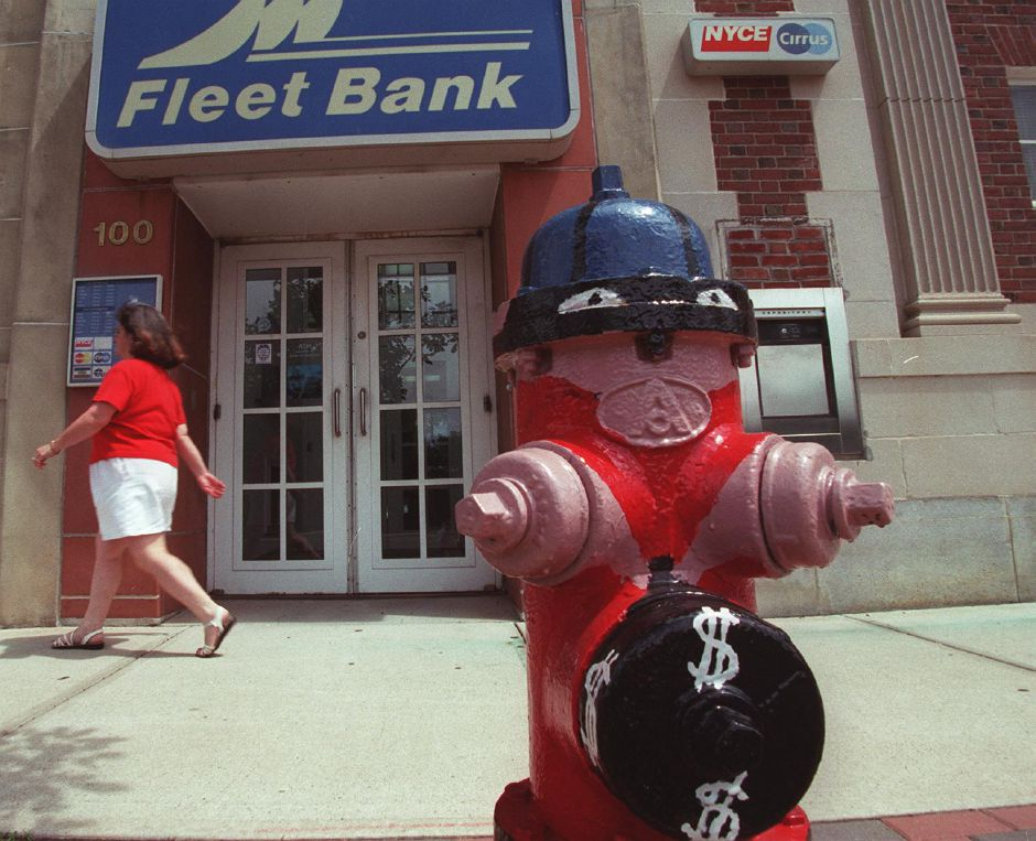 A creatively painted fire hydrate with little eyes and dollar signs on it stands outside of a bank on Center Street in Wallingford July 14, 2000.