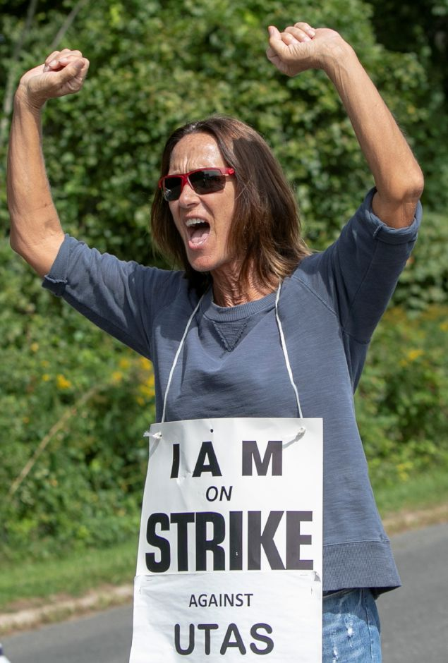 Lori Cosgrove, of Naugatuck, chants with other employees of UTC Aerospace Systems while walking the picket line in front of the business on Knotter Drive in Cheshire, Monday, Sept. 17, 2018. Cosgrove has been employed by the company for 44 years. Dave Zajac, Record-Journal