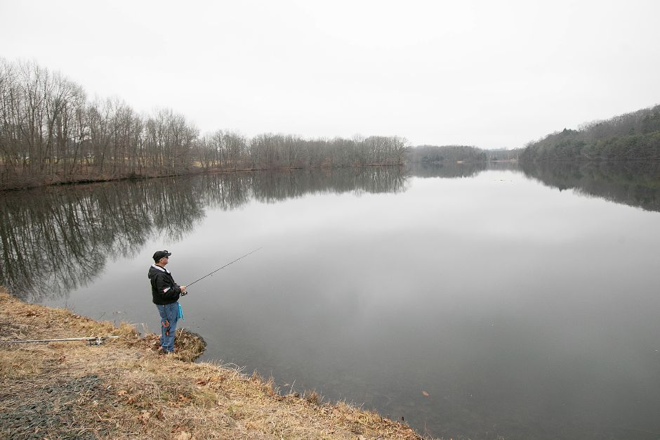 A local angler waits for a bite while fishing a calm Mackenzie Reservoir in Wallingford earlier this year. The town is considering a ban on the use of lead when fishing in municipally owned bodies of water. Dave Zajac, Record-Journal
