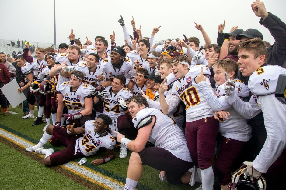 The Sheehan Titans celebrate after defeating Bloomfield on Saturday for the CIAC Class S state football championship at Trumbull High School. Aaron Flaum, Record-Journal