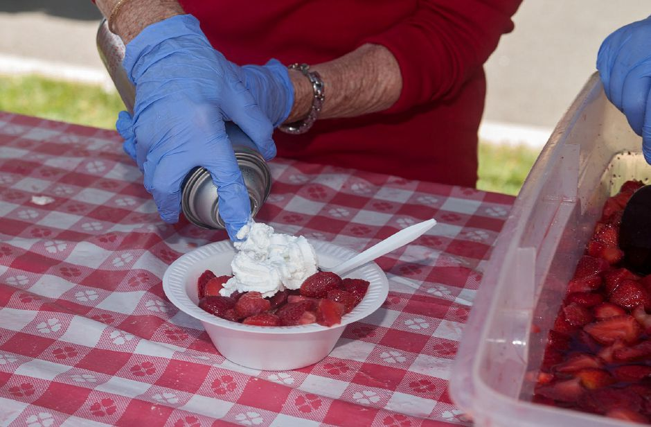 Whip cream was generously applied a strawberry shortcake at the 2019 Cheshire First Congregational Church Strawberry Festival. Photo by Al Valerio.
