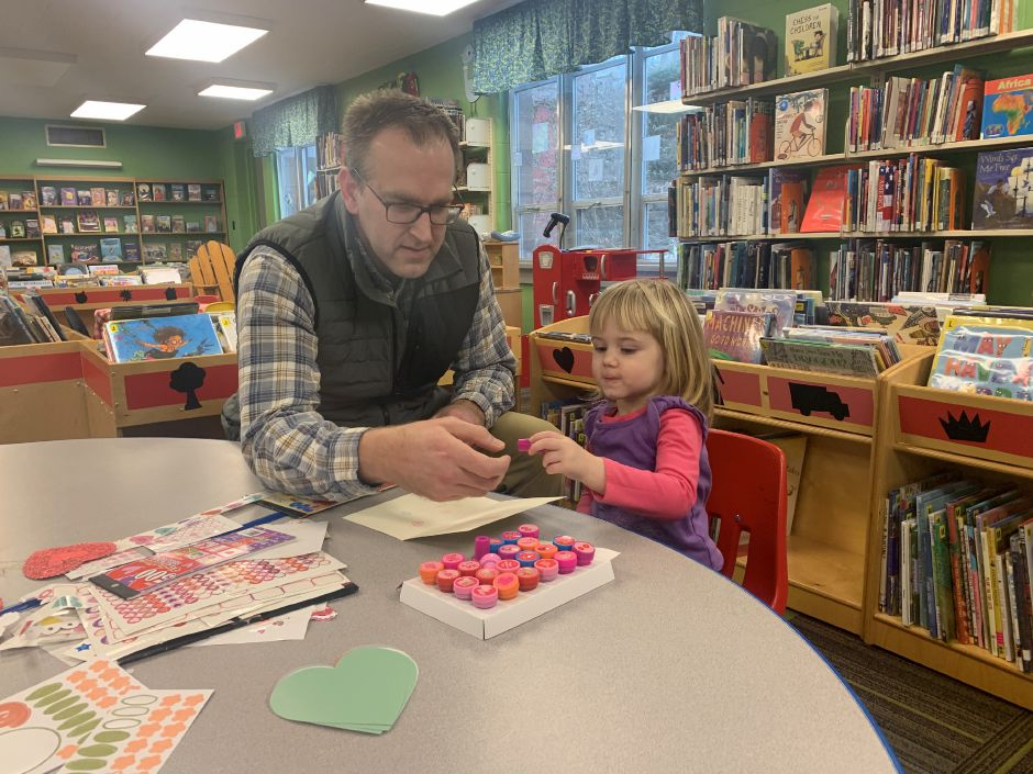 Aaron Mortensen (right) and his daughter Reagan (left) went to the Levi E. Coe Library on Saturday, Feb. 1, to make Valentine