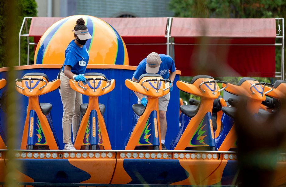 Ride attendants at the Rev-O-Lution wipe down seats between rides at Lake Compounce on Tuesday, July 7, 2020. Aaron Flaum, Record-Journal
