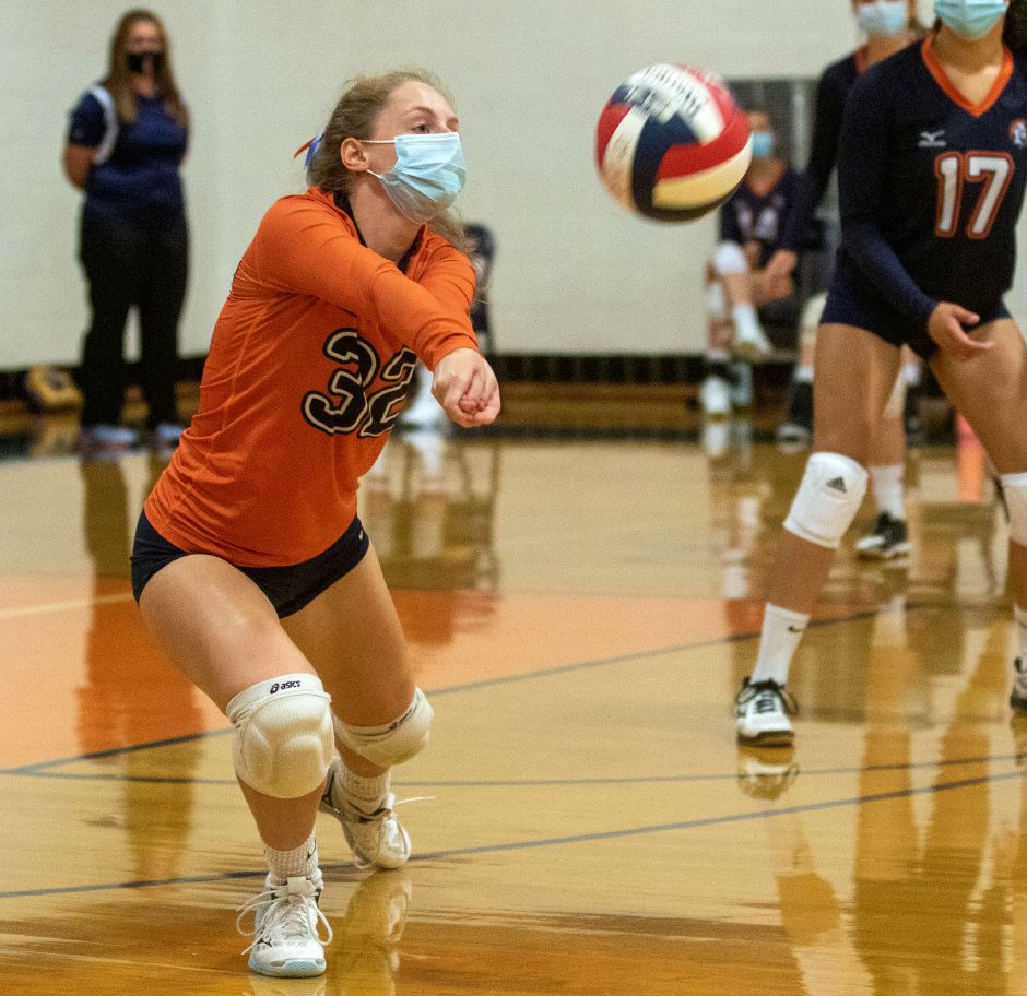 Lyman Hall's Katie Madow bumps a serve from Sheehan during a match-up at Lyman Hall on Thursday, October 15, 2020. Aaron Flaum, Recor-Journal