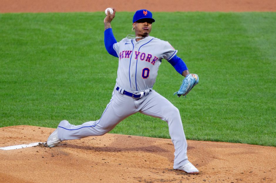 New York Mets starting pitcher Marcus Stroman (0) throws during the first inning of a baseball game against the Philadelphia Phillies, Tuesday, April 6, 2021, in Philadelphia. (AP Photo/Laurence Kesterson)