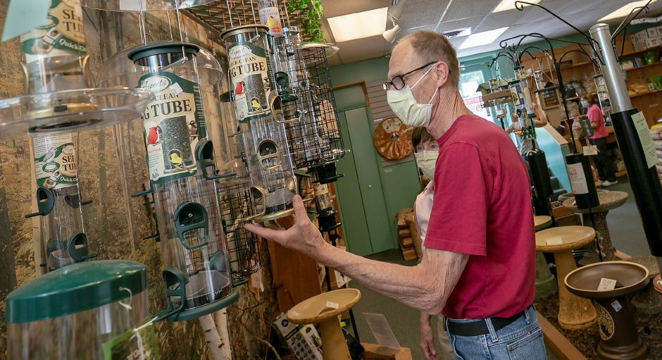 Dan Van Epps, of Bethany, looks over bird feeders on Tuesday at The Fat Robin Wild Bird and Nature Shop, 3000 Whitney Ave., Hamden. Since the pandemic started, the Audubon Society and others have noticed increased interest in observing wildlife, including birdwatching. Photos by Dave Zajac, Record-Journal