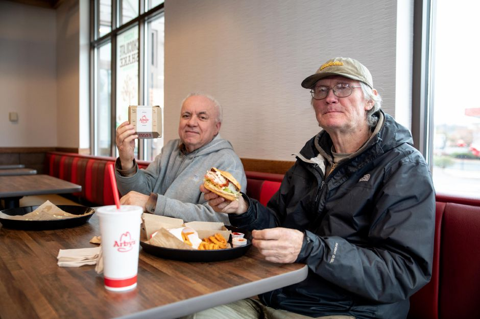 John Chrissluis, left, and Mike Comba have lunch at Arby