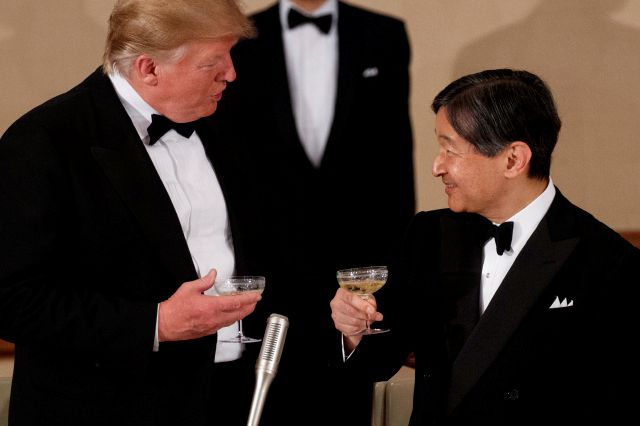U.S. President Donald Trump toasts with Japan