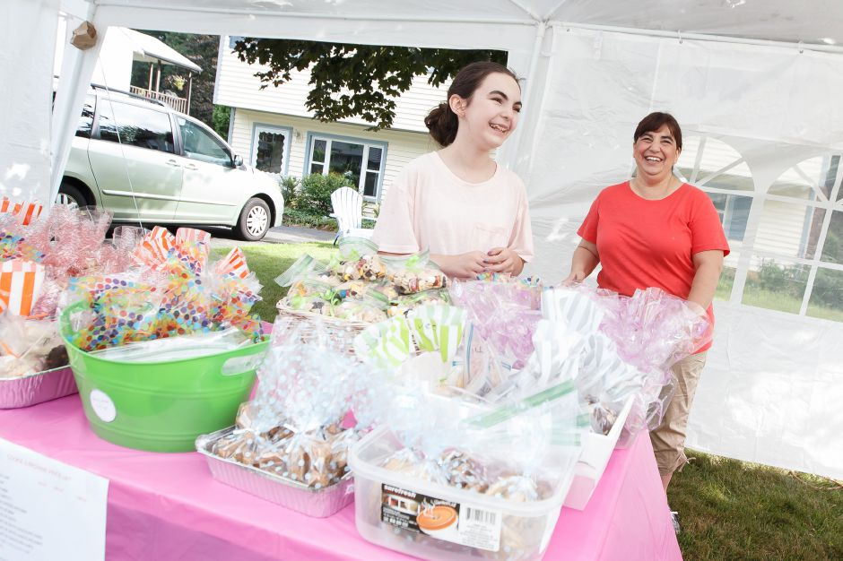 Chelsea Fizgerald 13 left and her mom Gina man the bake sale table at their home in Wallingford Saturday during the 6th Annual childrens book drive to benefit Read to Grow July 28, 2018 | Justin Weekes / Special to the Record-Journal