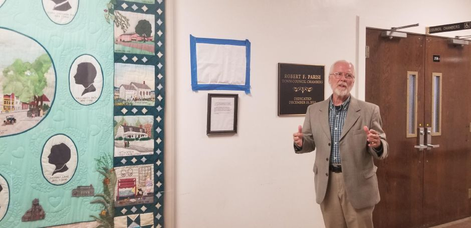 Resident Lawrence Takores beside the town's 325 anniversary quilt which he helped to design. A commemorative plaque was unveiled in the Wallingford Town Hall to honor the residents who were involved with the original project. Wallingford Town Hall. Aug. 20, 2019. Jeniece Roman, Record-Journal.