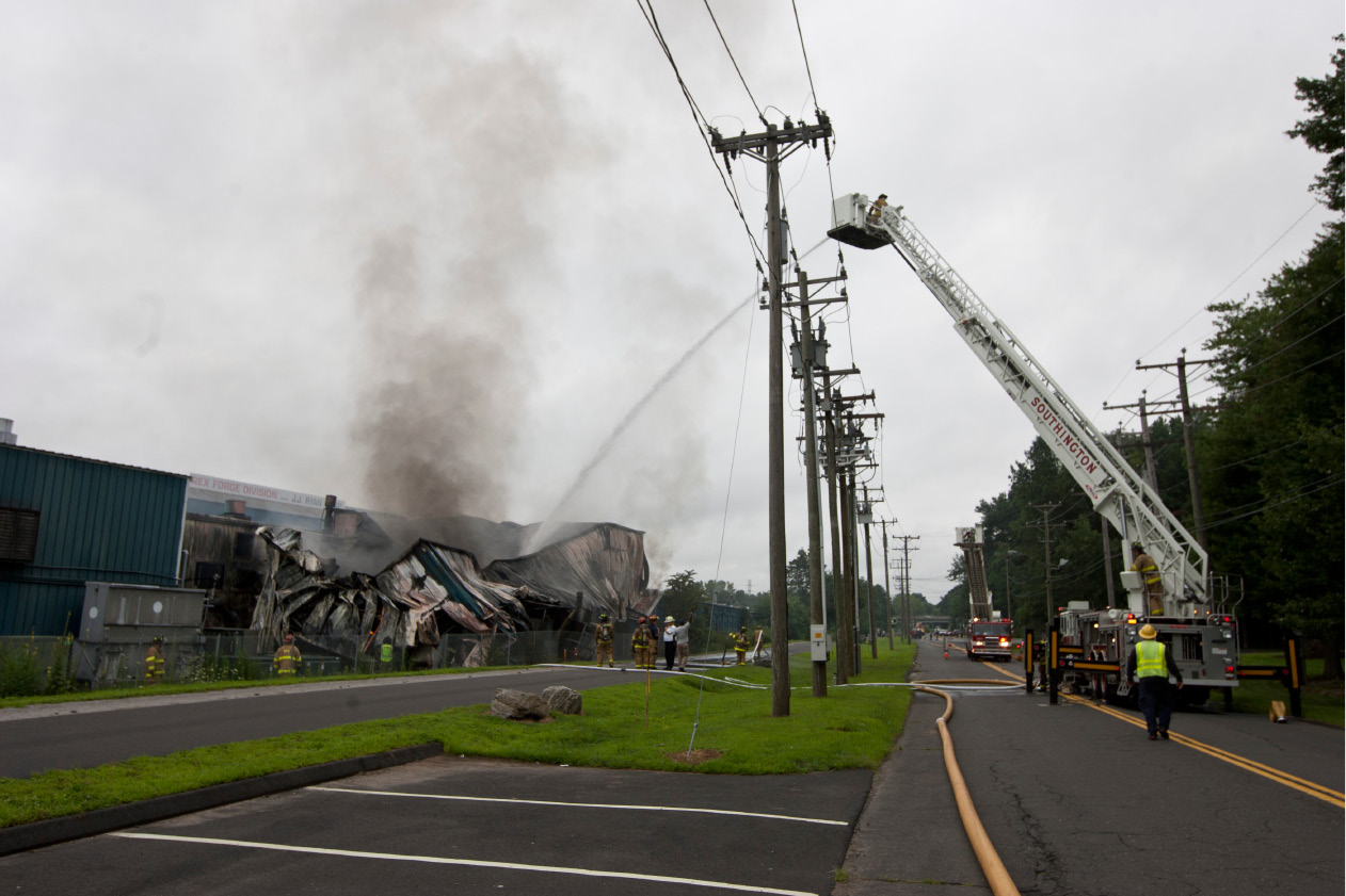Firefighters battle a blaze at the Rex Forge factory in Southington on July 31, 2012. | File photo, Record-Journal