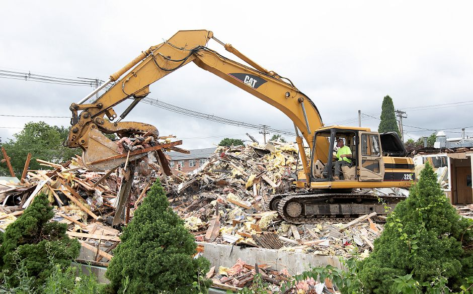 A worker from Pequabuck based Ludlow Associates operates an excavator while demolishing the former Brothers Restaurant in Wallingford, Tues., July 23, 2019. Dave Zajac, Record-Journal