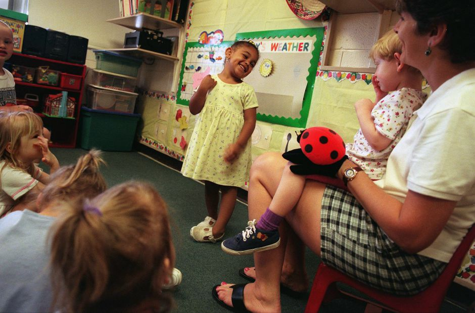 RJ file photo - Kala Slade,3, ( center) is all smiles as she answers a question from pre - K teacher Nancy Sylvester at the Margaret C. Griffin Child Developement Center June 9, 1999. Seated in Nancy