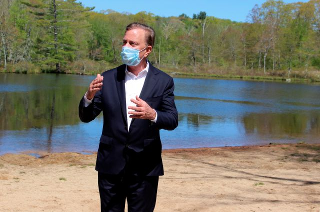 Connecticut Gov. Ned Lamont speaks to reporters at Gay City State Park in Hebron, Conn. on Thursday May 21, 2020. The governor held his daily COVID-19 briefing for the media at the park in advance of the Memorial Day weekend. (AP Photo/Pat Eaton-Robb)