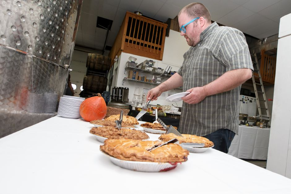 Eddie Hollenbeck of Plainville gets some pie for dessert Saturday during Lyman Orchards catered St. Patrick