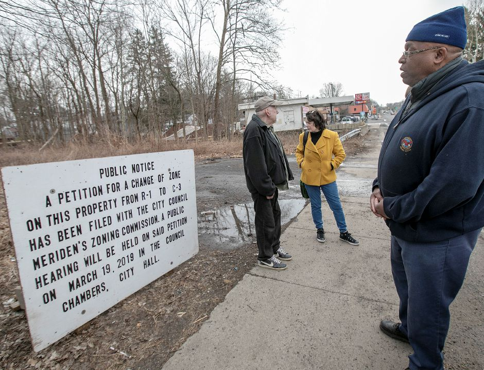 Twiss Avenue residents, from left, Joaquim Costa, Laura Ritter and Kevin Dossilva are concerned with the proposal for a car wash on Broad Street across from Ted's Restaurant in Meriden. Dave Zajac, Record-Journal
