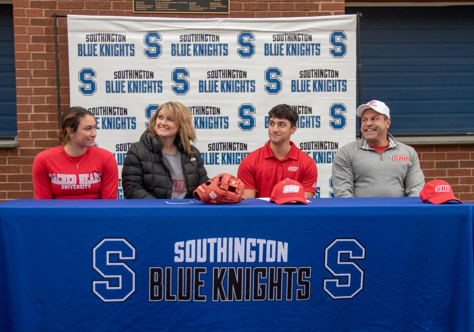 Southington's Dante Damore signs a National Letter of Intent to play baseball at Sacred Heart University. He was joined at the signing ceremony  at Southington High School by sister Bianca, mother Maria and father Antonio. Aaron Flaum, Record-Journal