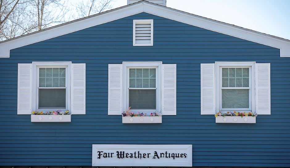 At left, an apartment above Fair Weather Antiques at 763 Hanover Road in  Meriden is seen on Friday.