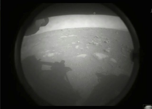 This photo made available by NASA shows the first image sent by the Perseverance rover showing the surface of Mars, just after landing in the Jezero crater, on Thursday.