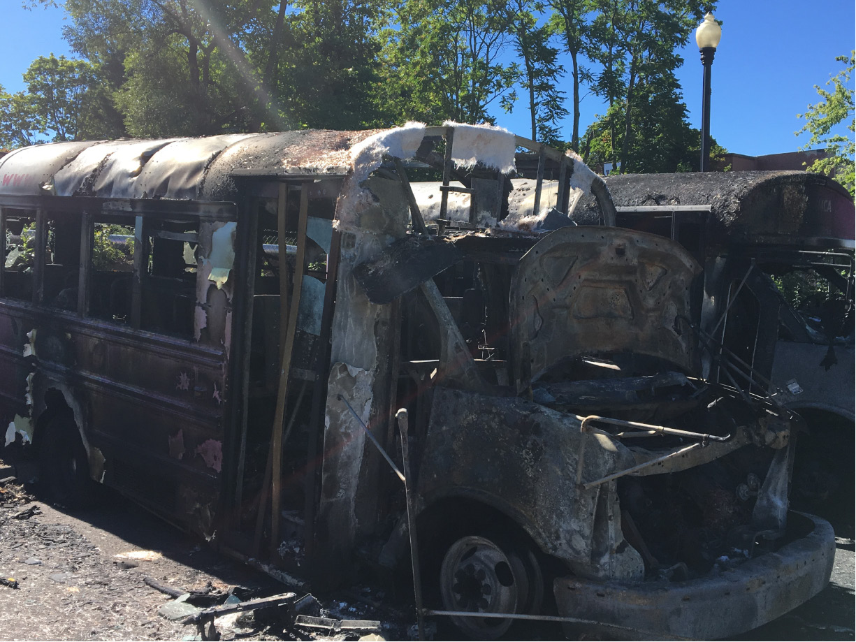 Two Meriden YMCA buses were destroyed by a fire early Monday in a parking lot of 44 Hanover St.| Pete Paguaga. Record-Journal