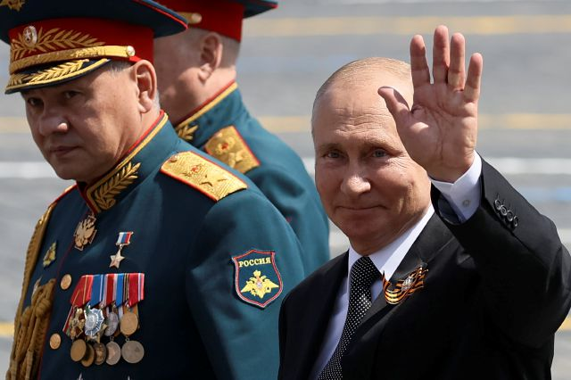 FILE - In this June 23, 2020, file photo, Russian President Vladimir Putin, right, and, Defense Minister Sergei Shoigu leave Red Square after the Victory Day military parade marking the 75th anniversary of the Nazi defeat in Moscow, Russia. Putin is just a step away from bringing about the constitutional changes that would allow him to extend his rule until 2036. The vote that would reset the clock on Putin's tenure in office and allow him to serve two more six-year terms is set to wrap...