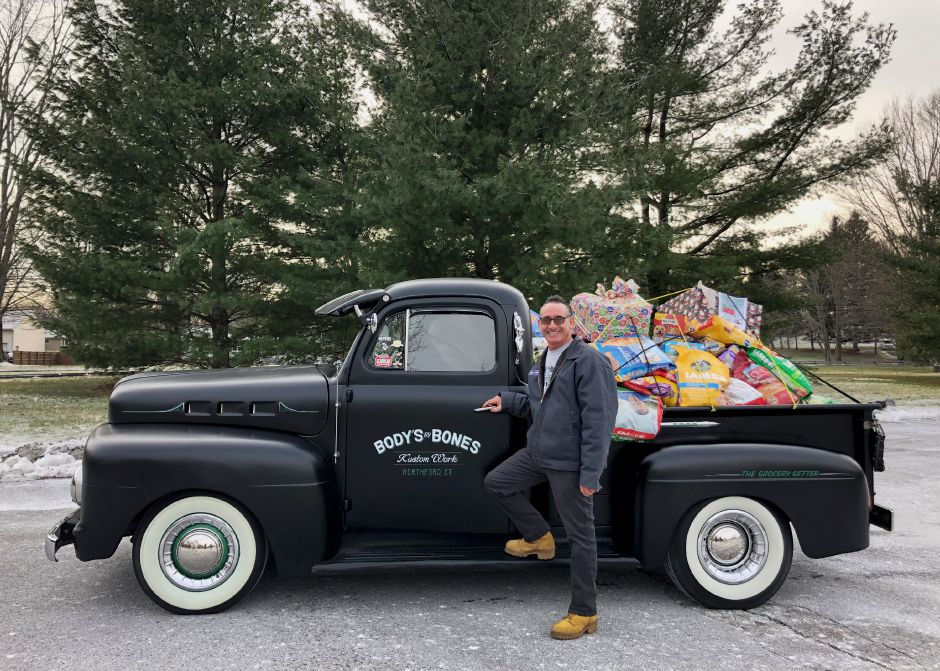 Larry Geraci's annual garage Christmas party brought in a big haul for the North Haven Animal Haven.