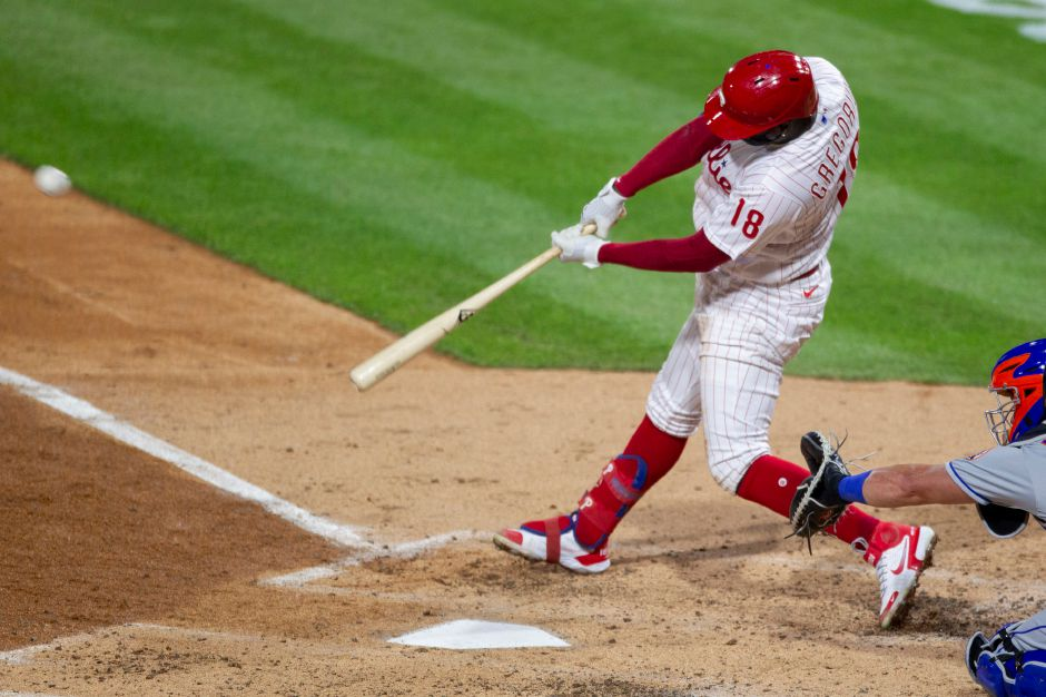 Philadelphia Phillies Didi Gregorius (18) hits a home run during the fourth inning of a baseball game against the New York Mets, Tuesday, April 6, 2021, in Philadelphia. (AP Photo/Laurence Kesterson)