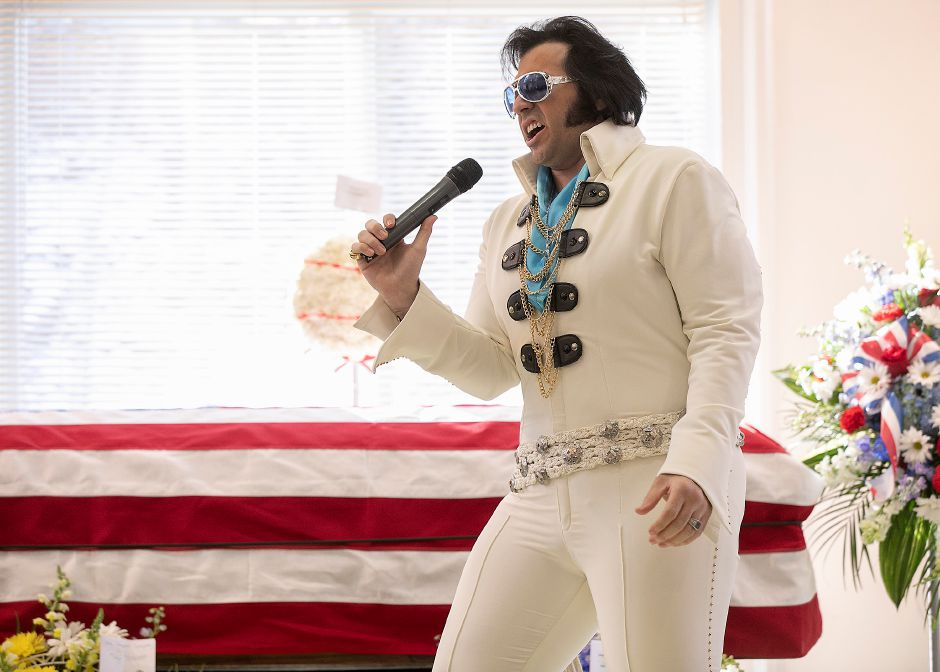 Elvis impersonator Lamar Peters, of NY, performs during a memorial service for Walter A. Shamock Jr. at the Augusta Curtis Cultural Center in Meriden, Thurs., Dec. 12, 2019. Shamock, a former realtor and Korean War veteran, was a longtime postal worker before he retired and joined the Meriden City Council in 1989. Dave Zajac, Record-Journal