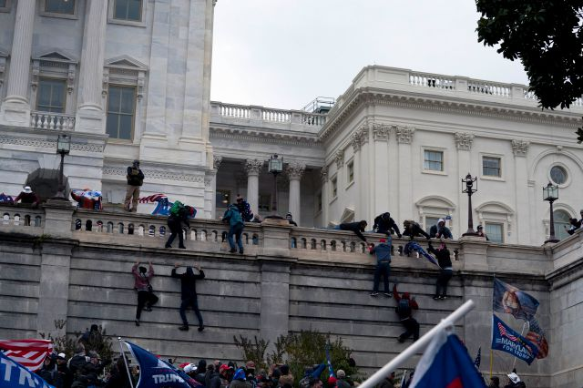 At right: Supporters of President Donald Trump climb the West wall of the  U.S. Capitol on Wednesday.