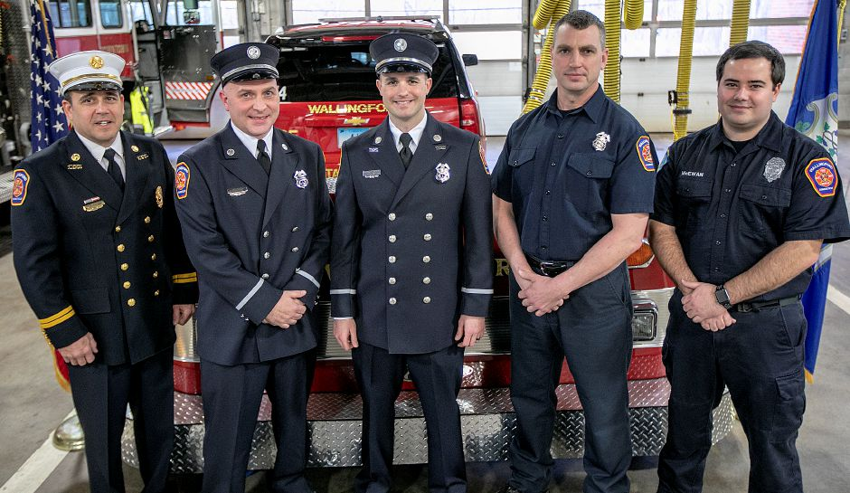 Left to right, Battalion Chief Robert Colangelo, Lt. Jeffrey Dingler, Lt. Aaron Desjardins, Firefighter Paramedic Daniel Telgarsky and Firefighter Paramedic James McEwan pose after sworn in during a ceremony at Wallingford Fire Headquarters, Wed., Jan. 30, 2019. Dave Zajac, Record-Journal
