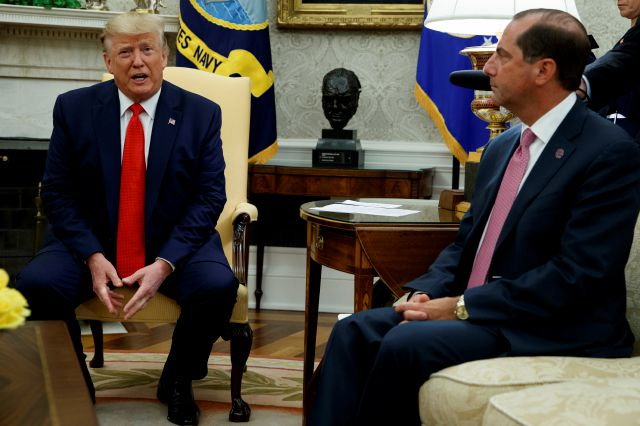 Secretary of Health and Human Services Alex Azar looks on as President Donald Trump talks about a plan to ban most flavored e-cigarettes, in the Oval Office of the White House, Wednesday, Sept. 11, 2019, in Washington. (AP Photo/Evan Vucci)