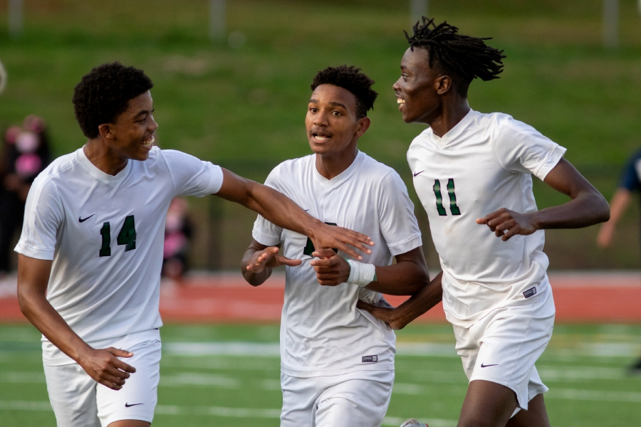 Jaden Myles, center, celebrates with Maloney teammates Kale Mullings, left, and Solomon Owusu after scoring in the second half to beat Platt 1-0 at Platt High School on Tuesday. Aaron Flaum; Record-Journal
