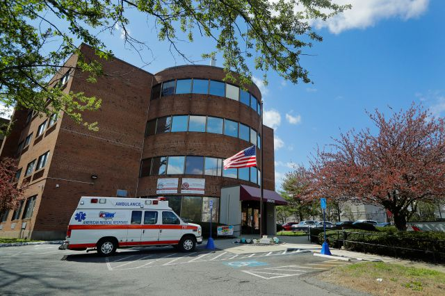 An ambulance used to transport a patient is parked outside the Northbridge Health Care Center Wednesday, April 22, 2020, in Bridgeport, Conn. (AP Photo/Frank Franklin II)