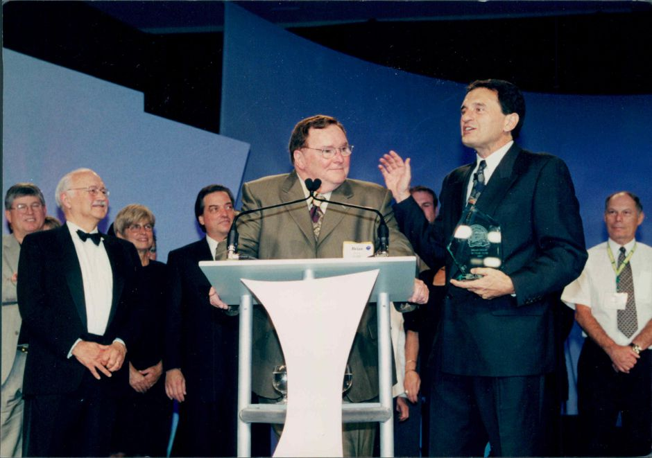 Wallingford franchisee Brian Dixon  is presented an award by franchiser Fred DeLuca, right, in an undated photo. Courtesy of Subway