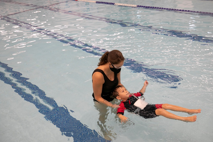 Suzy Clemente, assistant aquatic director, instructs Jacob Spector, 3, of Southington, during a swimming lesson at the Southington Community YMCA, Fri., Sept. 18, 2020. Dave Zajac, Record-Journal