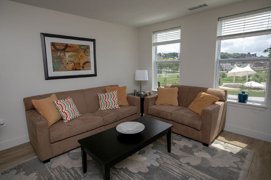 The living room in a model apartment on the fourth floor of the Meriden Commons, Tuesday, July 24, 2018. State and local leaders, and developers celebrated the completion of the $25 million mixed income Meriden Commons I project and the start of construction on Meriden Commons II. About 100 people attended the ribbon cutting ceremony at the amphitheater on the Meriden Green. Dave Zajac, Record-Journal