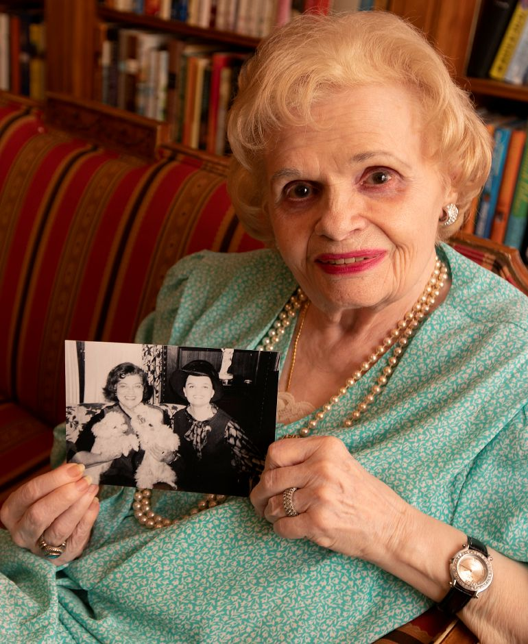 Opera singer Virginia Gordoni shows a photo of her with Rosa Ponselle at The Bradley Home and Pavilion, Wed., Apr. 17, 2019. Gordoni is seen on the right in the photo. Dave Zajac, Record-Journal