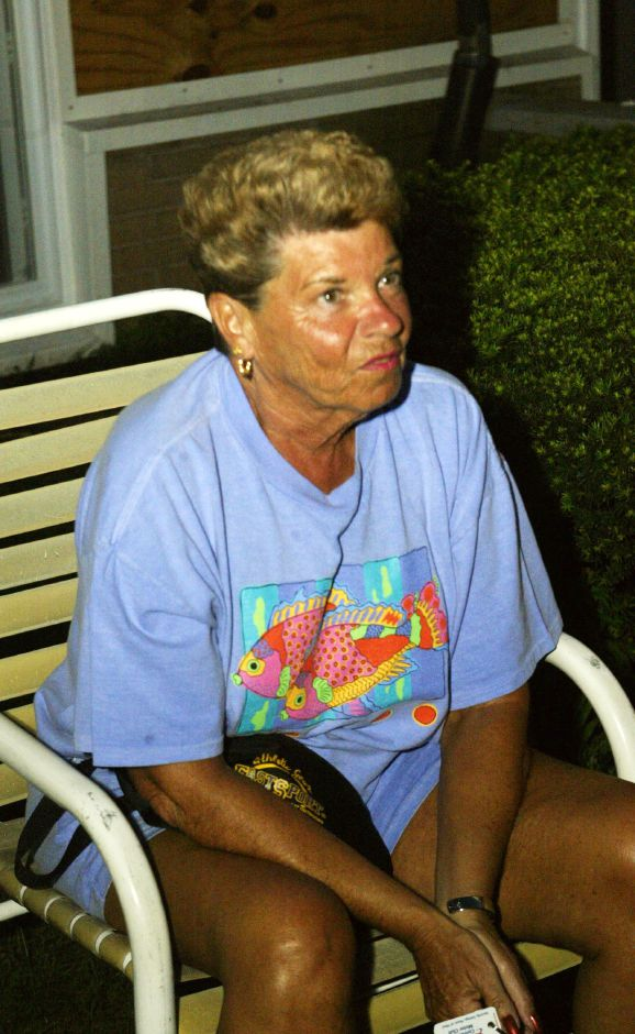 Victoria Towers resident Gloria Despres outside Thurs. night, Aug. 14 during the blackout in Meriden.