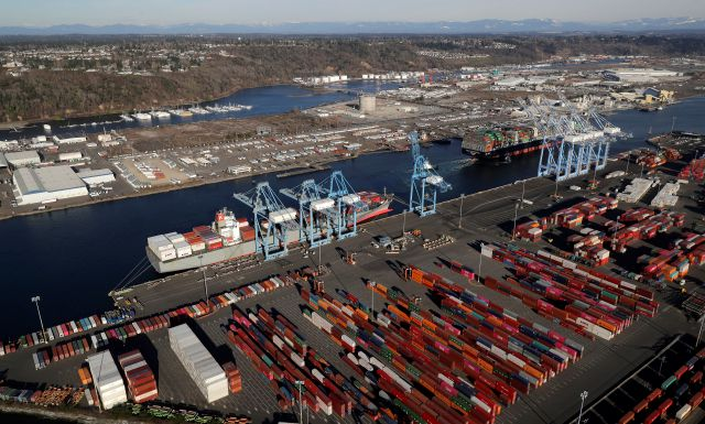 FILE - In this March 5, 2019, file photo, cargo containers are staged near cranes at the Port of Tacoma, in Tacoma, Wash. China has announced tariff hikes on $60 billion of U.S. goods in retaliation for President Donald Trump