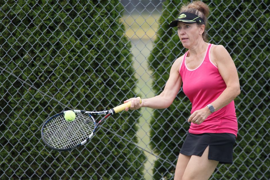Zofia Lavoie returns a volley in the Women Doubles match Sunday during the Wayton Open finals at Southington High School in Southington July 15, 2018 | Justin Weekes / Special to the Record-Journal