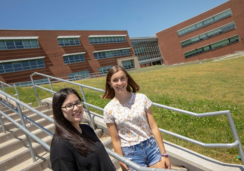 "Students Kelly Tran, 17, left, and Emma Burns, 17, pose for a photo in front of Maloney High School on Thursday. Tran's ""My Purpose, My Actions, My Life"" won best essay and Burns' ""My Biggest Fear"" was the school's top speech in the 128th Annual Hicks Essay & Speech Contest. Dave Zajac, Record-Journal"