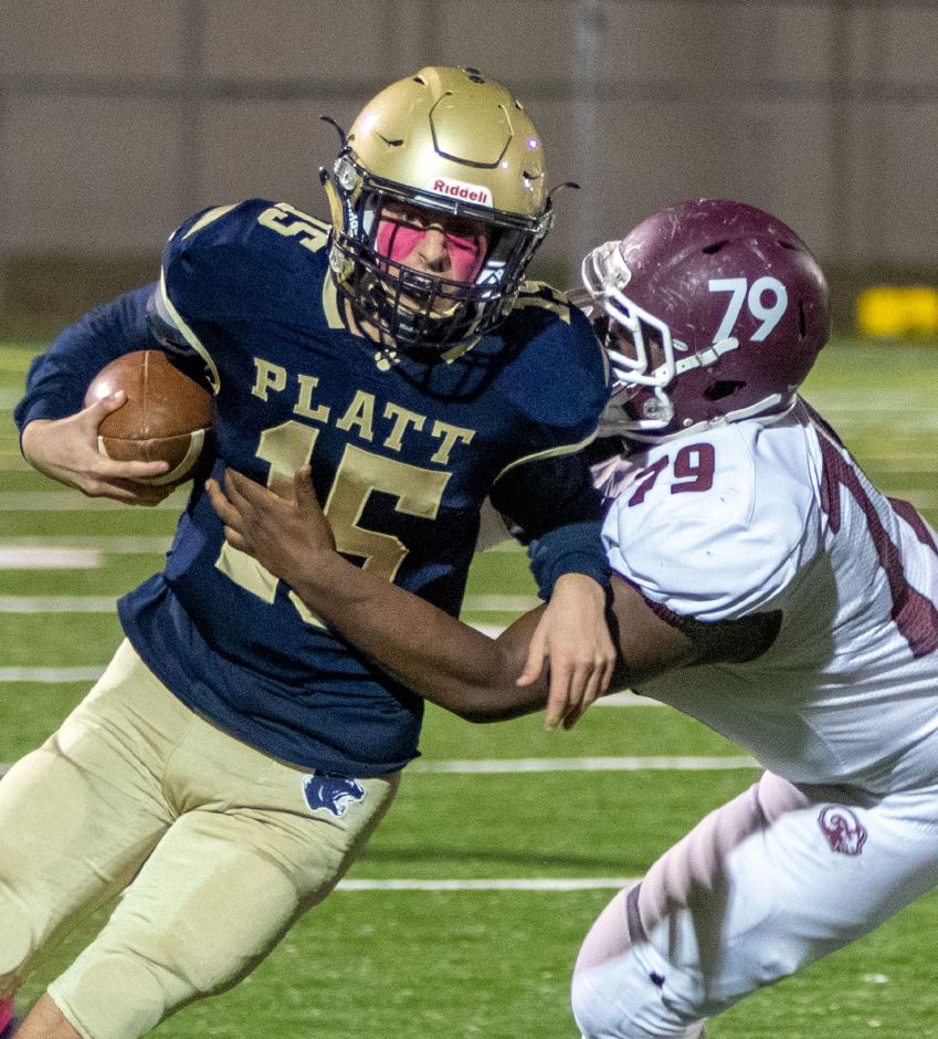 Platt quarterback Blaise Lanoue is forced out of bounds by Bristol Central