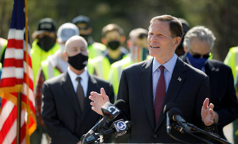 U.S. Sen. Richard Blumenthal speaks in support of President Joe Biden's American Jobs Plan during a press conference held in the commuter lot on Bee Street near interstates 91, 691 and Route 15 in Meriden, Mon., Apr. 19, 2021. A $300 million plan to improve the convoluted traffic triangle at the junction of interstates 691, 91 and Route 15 has been divided into three phases. Dave Zajac, Record-Journal